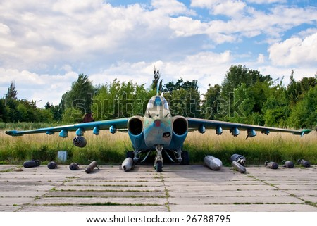 Combat airplane with a selection of weapons - stock photo