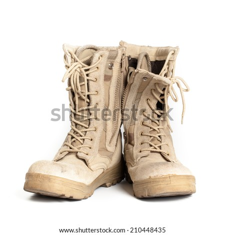 Combat boots on isolated white background - stock photo