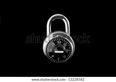 Combination lock against black.