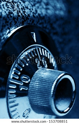 Combination lock. Dark blue colorized. Shallow DOF. Safety concept. - stock photo
