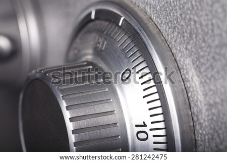 combination lock on the safe closeup gray - stock photo