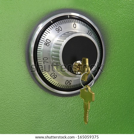 combination lock on the safe with two keys - stock photo