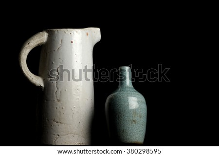 Combination of a large white jag with a small blue vase - stock photo