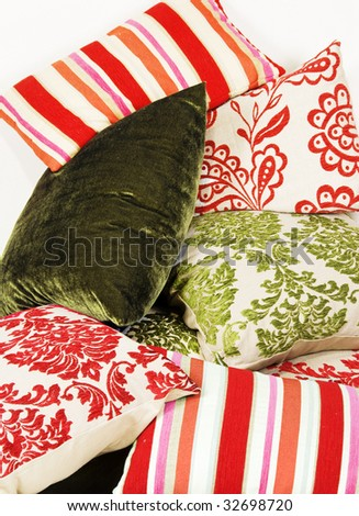 Combination of different cushions in red and green - stock photo