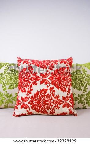 Combination of red and green pillows - stock photo