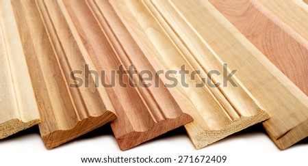Combination of Wooden Skirting boards over white - stock photo