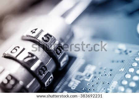 combination padlock on motherboard computer for security concept - stock photo