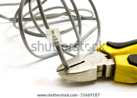 combination pliers cutting a network cable