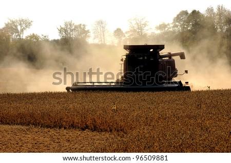 Combine Harvester harvesting crop - stock photo