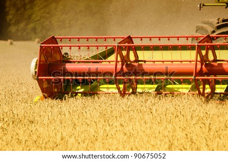 combine harvester reaps the corn - stock photo