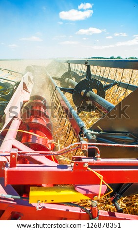 combine harvester very close up - stock photo