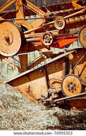 Combine harvester working in a wheat field - stock photo
