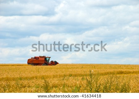 combine harvester working on a wheat crop