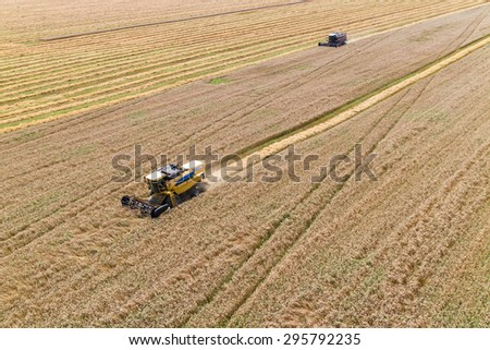 Combine Harvesting a Fall Corn Field Aerial