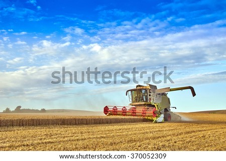 Combine harvesting on the South Downs - stock photo