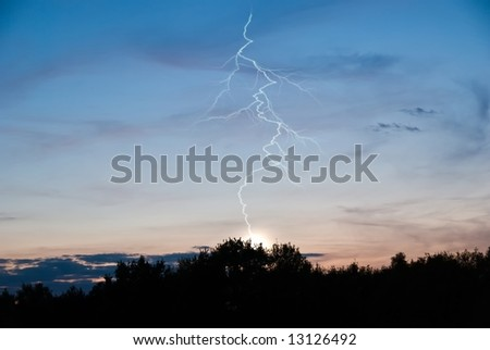 Combined photography and 3D render of a lightning. - stock photo