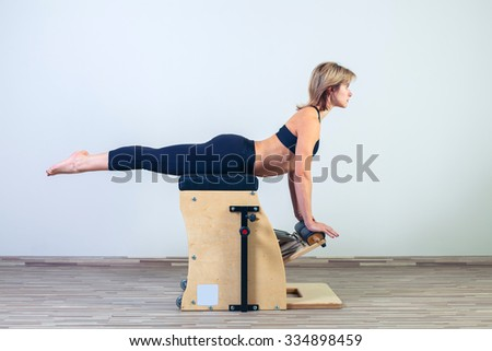 combo wunda pilates chair woman fitness yoga gym exercise. - stock photo