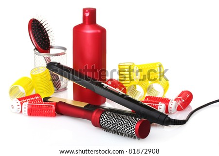 combs, curling iron and hair curlers isolated on white - stock photo