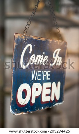 Come in we are open sign on a shop window