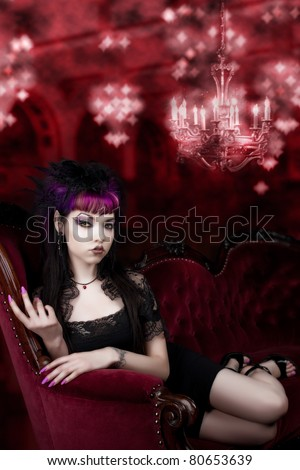 Come into my Lair - Vampire on red Velvet Couch - stock photo