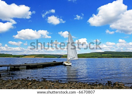 Come sail away, a yacht and a lake all to your own - stock photo