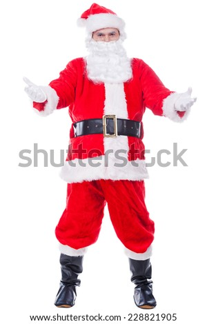 Come to Santa! Full length of Traditional Santa Claus carrying sack with presents and waving to you while standing against white background - stock photo