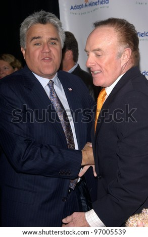 Comedian JAY LENO (left) & actor JAMES CAAN at the 4th Annual Adopt-A-Minefield Gala at the Century Plaza Hotel, Beverly Hills, California. October 15, 2004 - stock photo