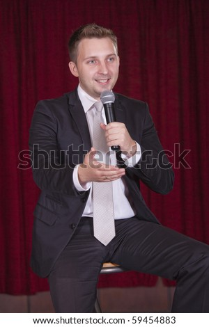 comedian on the stage talking with audiences - stock photo