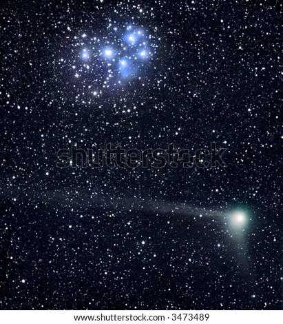 Comet C/2004 Q2 crosses the Pleiads - stock photo