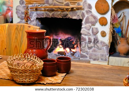 comfort of home hearth with a jug of wine - stock photo