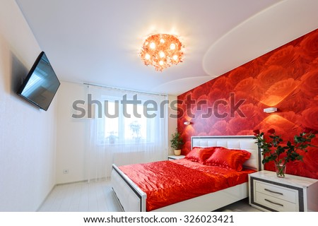 Comfortable and cozy white and red bedroom - stock photo
