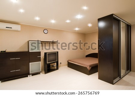 Comfortable apartment with a double bed, modern design - stock photo
