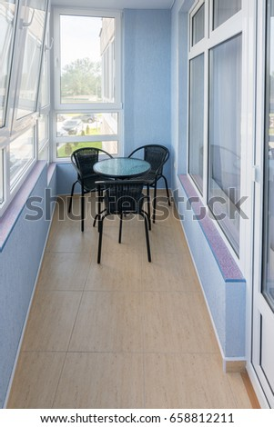 Comfortable balcony in the apartment of a multistory apartment house