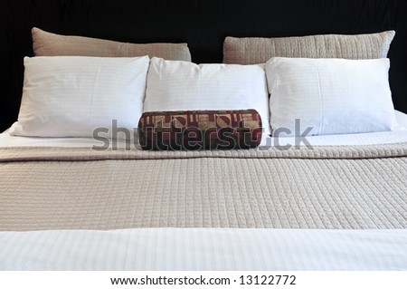 Comfortable bed in upscale hotel close up - stock photo