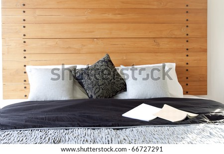 Comfortable bed with pillow - stock photo