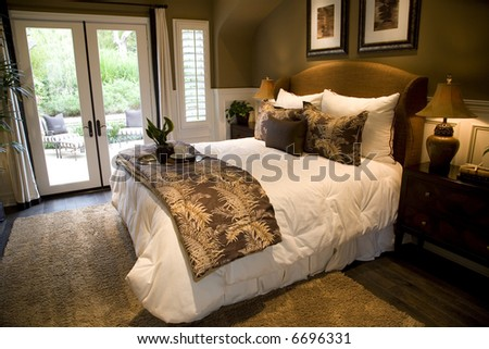 Comfortable bedroom in a luxury home with stylish decor. - stock photo