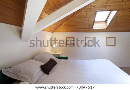 comfortable bedroom in loft - stock photo