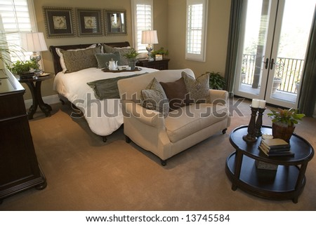 Comfortable bedroom with lounge area. - stock photo