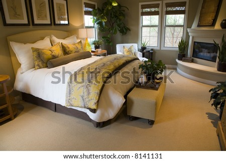 Comfortable bedroom with lounge area and modern fireplace. - stock photo