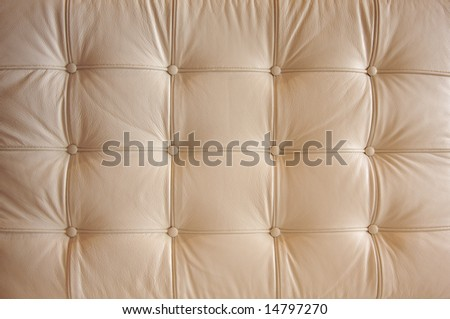Comfortable Buttoned Leather Pattern with dramatic lighting. - stock photo