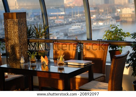 comfortable cafe in bridge over the river at sunset