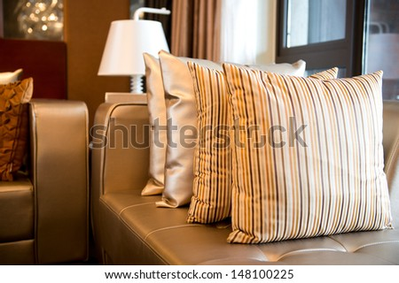 Comfortable corner in family room, with many pillows. - stock photo