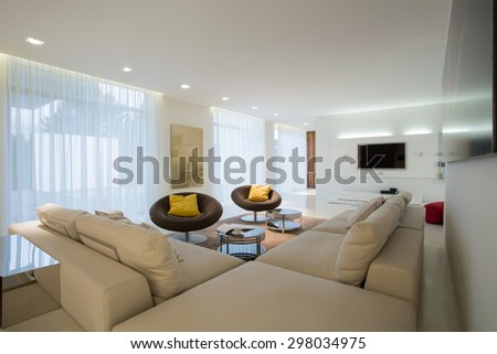 Comfortable corner sofa in contemporary drawing room - stock photo
