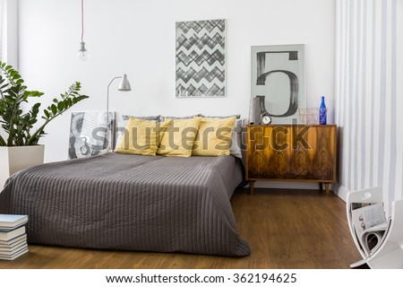 Comfortable double bed in modern stylish bedroom - stock photo