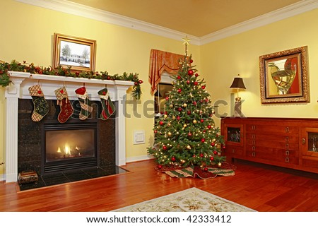 Comfortable Home with Fire Place and Christmas Tree - stock photo