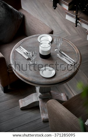 comfortable interior with served table and two armchairs  - stock photo