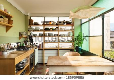 comfortable kitchen, interior of a nice loft - stock photo