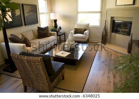 Comfortable living room with fireplace and stylish decor. - stock photo