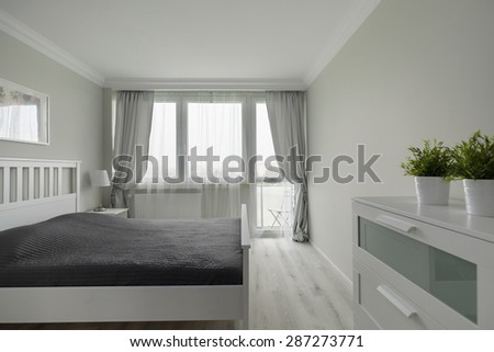 Comfortable marriage bed in luxury modern bedroom - stock photo