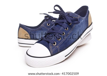Comfortable men's sports sneakers .Convenient for sports mens sneakers in blue thick fabric on a white background. - stock photo